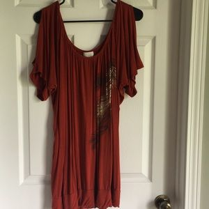 Burnt orange dressy top with slits in arms.